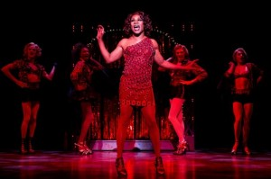 Billy Porter as Lola and the cast of Kinky Boots